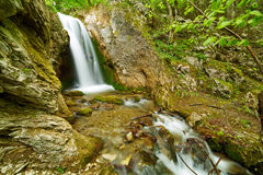 Waterfall on a mountain river Stock Images