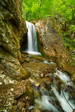 Waterfall on a mountain river Royalty Free Stock Image