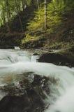 Waterfall on mountain river Stock Photo