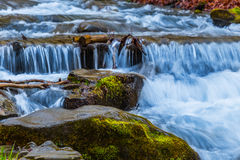 Waterfall on a mountain river Stock Image