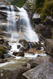 Waterfall on the mountain river. High beautiful waterfall on a mountain river royalty free stock images