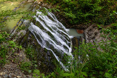 Waterfall on a mountain river Stock Photo
