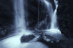Waterfall on mountain river with water flowing Stock Images