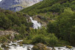 Waterfall of a mountain river Stock Images