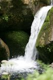 Waterfall on mountain rivulet Stock Photography