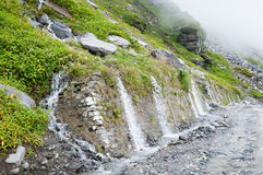 Waterfall on a mountain road Royalty Free Stock Image