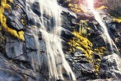 Waterfall in mountain rocks Stock Photo