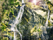 Waterfall in mountain rocks Stock Images