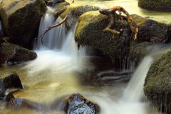 Waterfall on a mountain stream Stock Images