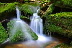 Waterfall on mountain stream. Stock Image