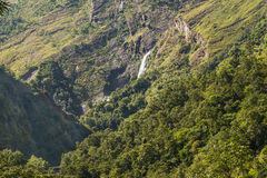 Waterfall in the mountain. View from the trekking at Annapurnas circuit, Himalaya, Nepal Stock Photography