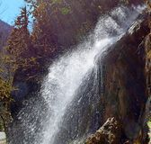 Waterfall in a mountainous and wooded area.  royalty free stock photography