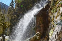 Waterfall in a mountainous and wooded area.  royalty free stock photo