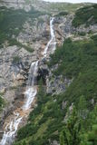 Waterfall in mountains. Scenic view of waterfall on Dolomite mountains, Italian Alps royalty free stock images