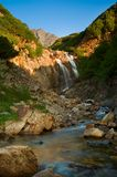 Waterfall in the mountains. Of the reserve Kony Peninsula Royalty Free Stock Images
