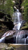 Waterfall in mountains. Waterfall with many rocks, located in the Blue Mountains, with water running down fall Royalty Free Stock Image