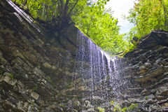 Waterfall. In the mountains against the sky Stock Photography