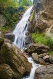 Waterfall in the mountains. Beautiful waterfall in the mountains of the Austrian Alps Stock Photos