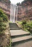 Waterfall in mountains at Chongqing. Beautiful high waterfalls in mountains in China's Chongqing Stock Images
