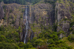 The waterfall with the mountains Stock Images
