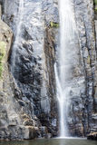 The waterfall with the mountains Royalty Free Stock Photo
