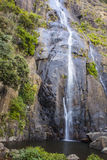 The waterfall with the mountains Royalty Free Stock Image