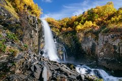 Waterfall in the mountains in the fall royalty free stock image