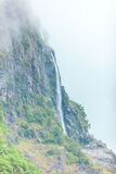 Waterfall in mountains foggy day, Norway. Royalty Free Stock Photography
