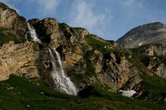 Waterfall in the Mountains Stock Photos