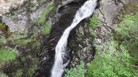 Waterfall in the mountains. Landscape with waterfall in the mountains stock video footage