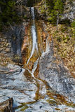 Waterfall in the mountains Stock Images
