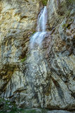 Waterfall in mountains Stock Image