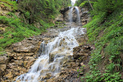 Waterfall in the mountains of the Lauterbrunnen valley in Switzerland. View at beautiful waterfall in the mountains of the Lauterbrunnen valley, in Switzerland stock photos