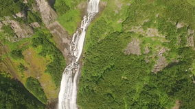 Waterfall in the mountains. Mountain river in the forest stock video