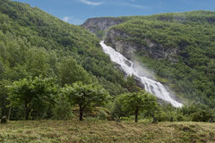 Waterfall in the Mountains Stock Photography