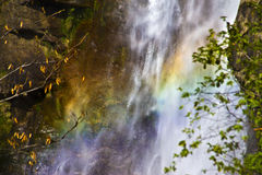 Waterfall in mountains and rainbow Royalty Free Stock Photo