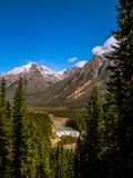 Waterfall in between mountains royalty free stock images