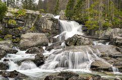 Waterfall in mountains. Stream tumbles through the valley forming cascades and waterfalls is Slovakia Tatra mountains stock photography