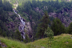 Waterfall in the mountains in summer Stock Photo