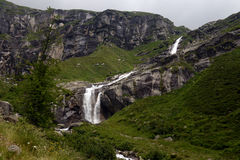 Waterfall in the mountains in summer Royalty Free Stock Photography