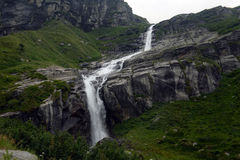 Waterfall in the mountains in summer Royalty Free Stock Photos