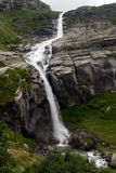 Waterfall in the mountains in summer Stock Photos