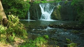 Waterfall in mountains stock footage