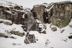 Waterfall in mountains at winter Stock Photo