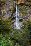 Waterfall on mountainside Stock Photo