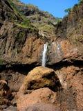 Waterfall on mountainside Royalty Free Stock Photo