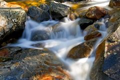 Waterfall movement on the rocks Stock Image
