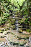 The waterfall at Muggio valley Stock Images