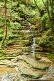 The waterfall at Muggio valley Stock Photos