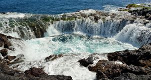 Waterfall in natural pool, coast of Gran canaria, Canary islands Royalty Free Stock Photos